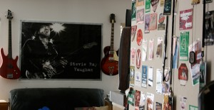 This is just a small part of my collection of photo/crew/press passes on the wall leading into our home studio that includes a large poster of Stevie Ray Vaughn  that is an image by Robert Knight.