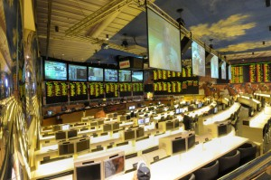 The dual screen's at the Bally's sports book keeps players up-to-date on all their bets. (photo courtesy of Harrah's Corp.)
