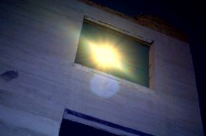 My favorite shot f the night. The full moon through one of the windows of the old Cook Bank.Photo by Osie Turner