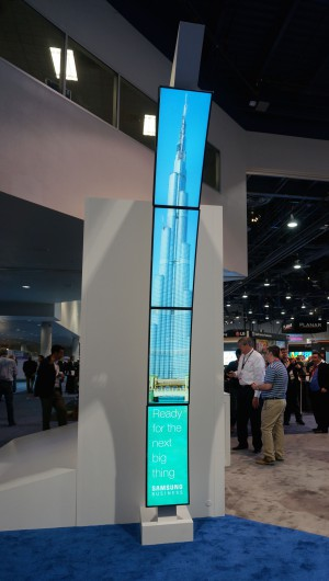 Digital signs come in all shapes and sizes.  This tall sign was part of the Samsung exhibit.  Photo by Diane Taylor
