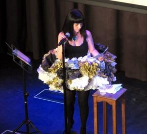 Dena Rash Guzman on stage opening night at Inspire Theater