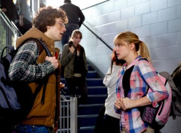 In civilian clothes, Kick-Ass (Aaron Taylor Johnson) and Hit Girl (Chloe Grace Moretz) try to live the lives of normal high schoolers. Photo: Daniel Smith,  © 2013 - Universal Pictures