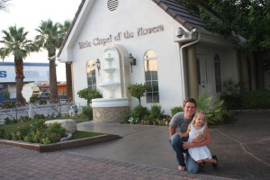 The future groom and my daughter pose in front of Little Chapel of the Flowers.