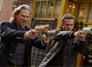 Roy (Jeff Bridges, left) and Nick (Ryan Reynolds) fight the evil dead with high-tech weaponry.  Photo by Scott Garfield – © 2013 - Universal Pictures