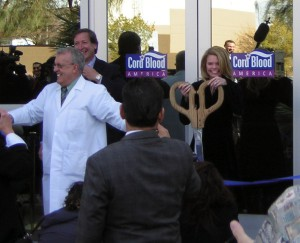 Dr. O\'Neill (in lab coat) after cutting the ribbon