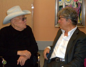 Tony Curtis chats with Norm Clarke before going on stage