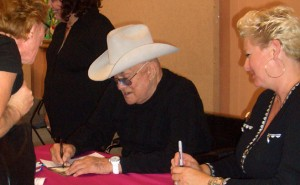 Tony Curtis signs a book for a fan